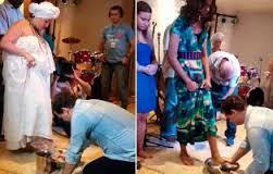 Pastor lava pés de mãe de santo e de travesti